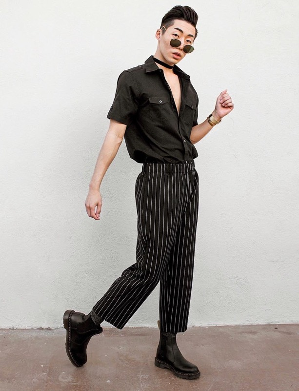 man wearing pinstripe trousers with black chelsea boots