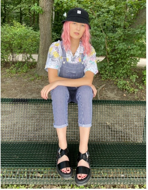 woman styling dr martens sandals with overalls